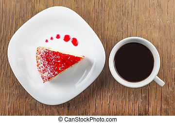 a piece of cake and a cup of black coffee