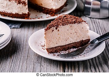 A piece of cold chocolate cheesecake on a plate