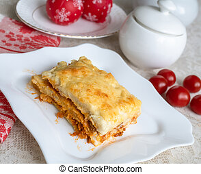 A piece of delicious homemade lasagna on a plate