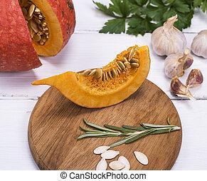 piece of fresh pumpkin with seeds