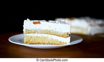 a piece of homemade sweet cake with cream and canned...