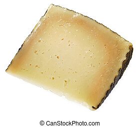 manchego cheese - a piece of manchego cheese on a white...