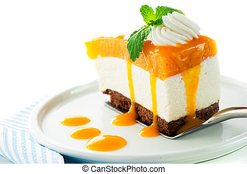 A piece of mango cheese cake on white background as a studio...