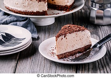 A piece of no-bake chocolate cheesecake on a plate