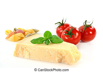 Parmesan - a piece of Parmesan cheese with basil and tomato