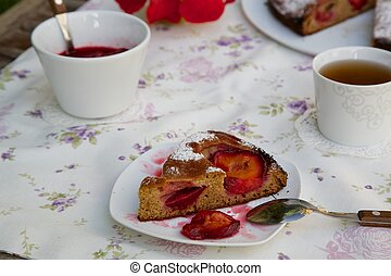 A piece of plum pie on a white plate