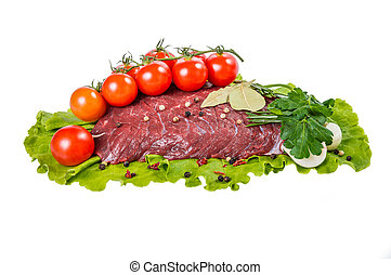 A piece of raw beef meat on lettuce isolated on white background