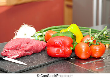 piece of raw meat with vegetables