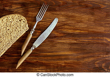 A piece of rye bread and cutlery