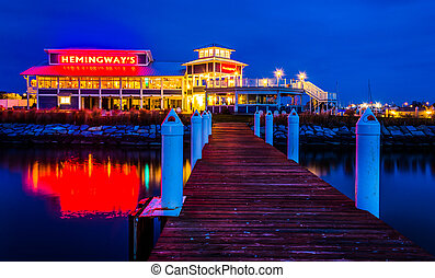 A pier and Hemingway's Restaurant at night, in Kent Island, ...