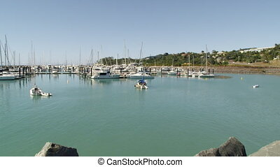 A pier full of yachts - A pan to left shot of a pier. White...