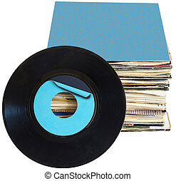 A pile of 45 RPM vinyl records used and dirty even if in good condition