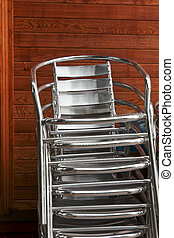 a pile of aluminum chairs