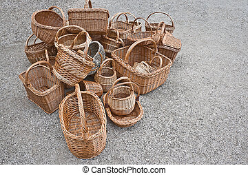 A pile of baskets are on the ground