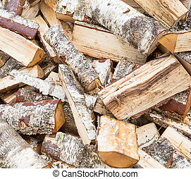 firewood - a pile of birch firewood in winter, texture,...