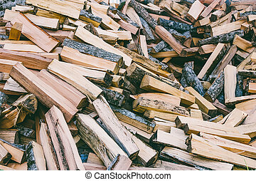 a pile of chopped wood for the stove and fireplace