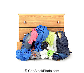 A pile of clothes falling out of the dresser isolated on white background