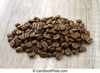 coffee beans on the wooden background
