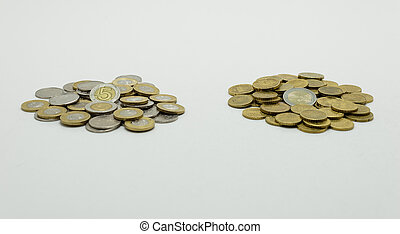 A pile of coins, the Polish currency PLN / Polish zloty and the European currency EURO Isolated on white background with clipping path.