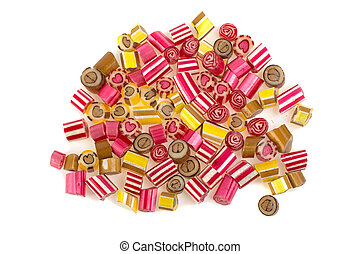 a pile of colorful lollies on a white background