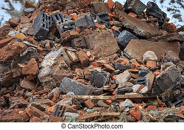 A pile of construction debris is broken brick and concrete.