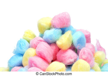 a pile of cotton balls of different colors on a white background