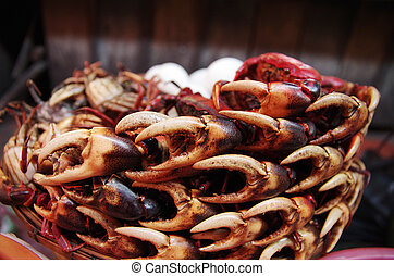 A pile of crab claws at a market - Dozens of crab claws ...