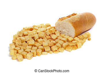 croutons - a pile of croutons and a piece of bread on a...