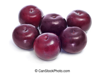 damson plums - a pile of damson plums on a white background