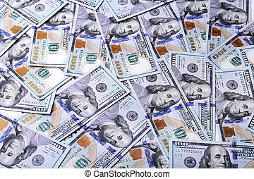 A pile of dollar bills. Background from american money one hundred dollars.