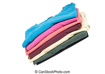 A pile of folded T shirts