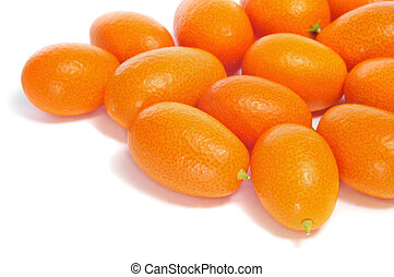 kumquat - a pile of kumquats on a white background