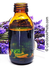 lavender essence - a pile of lavender flowers and a dropper...