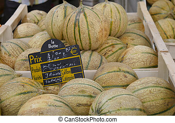 pile of melons on the market