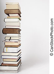 A pile of new and old books on a white grey background - A ...