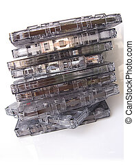 A pile of old fashioned cassette tapes, isolated in white
