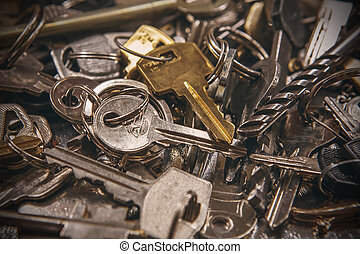 A Pile of old Keys different shapes and colors. Many vintage keys