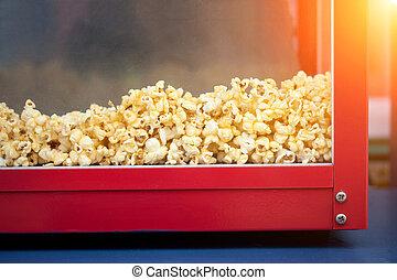 A pile of popcorn in a popcorn maker - popcorn for sale in...