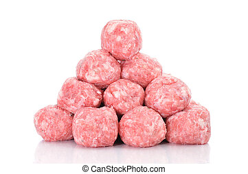 raw meatballs - a pile of raw meatballs on a white ...
