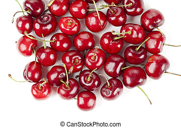 a pile of red cherries