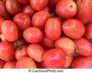 A Pile Of Red Tomato