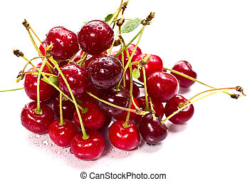 A pile of ripe cherries on white background