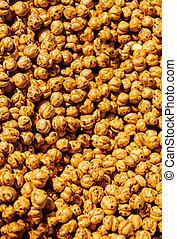 A pile of roasted chickpeas on display