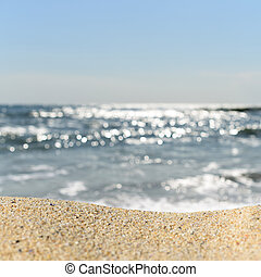 A pile of sand on a beach against the sea and sky. Ready for...