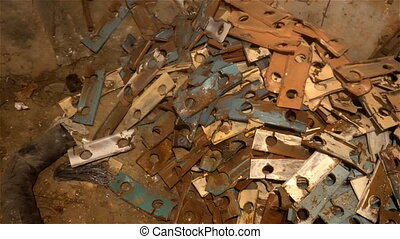 a pile of scrap metal lying on the floor in the basement.