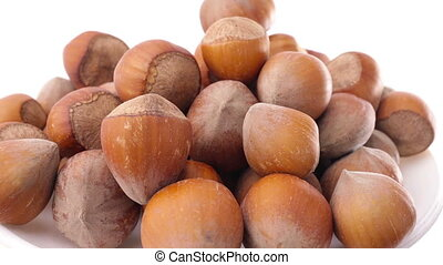 A pile of shelled hazelnuts rotating smoothly. Tripod used...