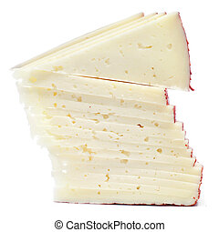 manchego cheese - a pile of slices of manchego cheese on a...