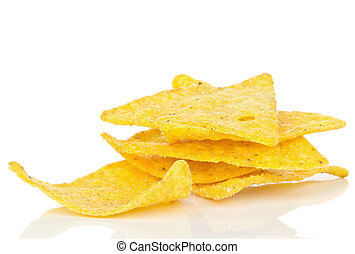 A small pile of tortilla chips on a white background