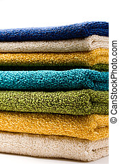 A pile of towels on white