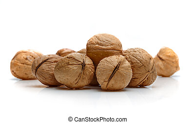A pile of walnuts on a white background